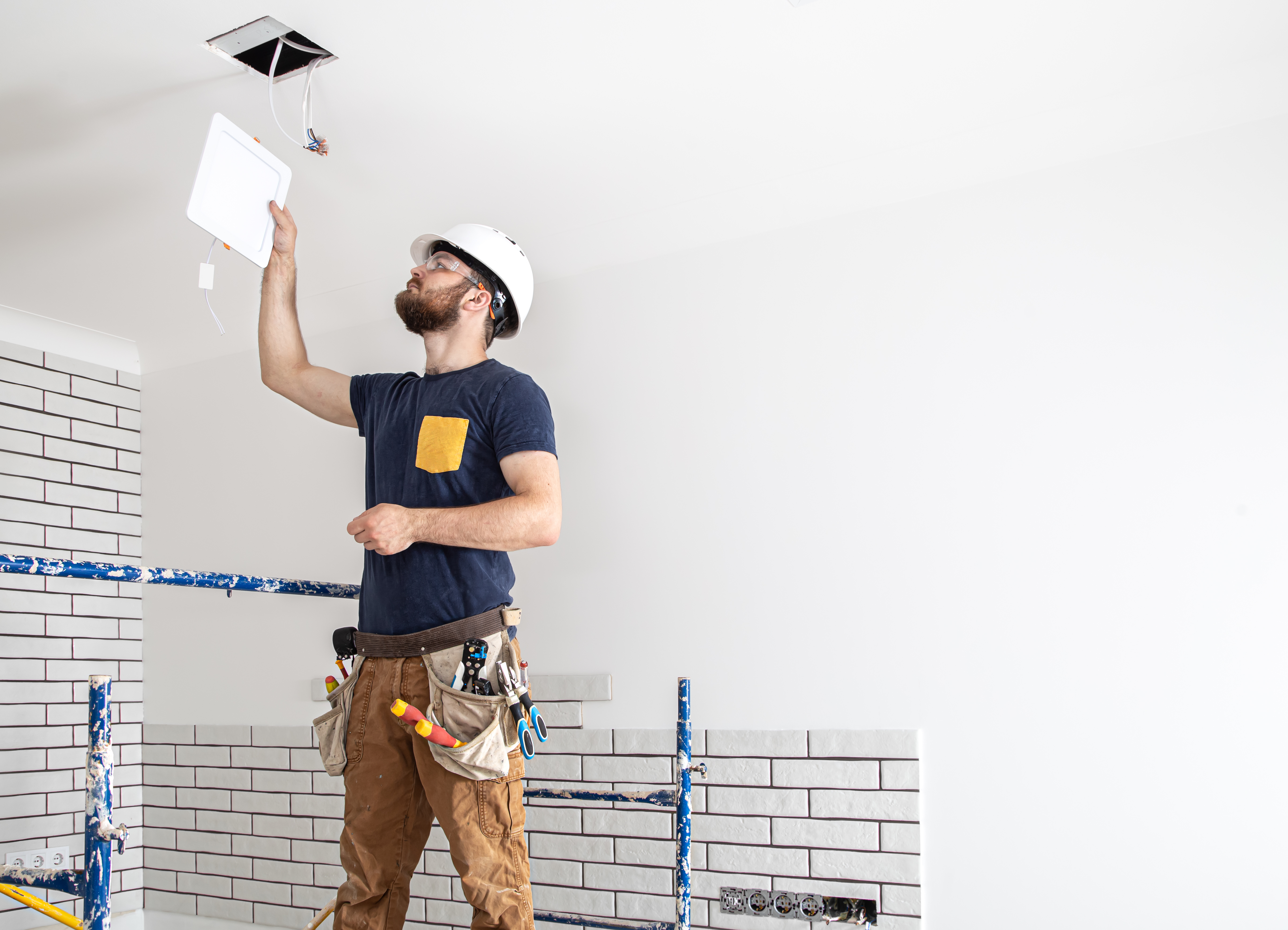 Electrician,builder,at,work,,installation,of,lamps,at,height.,professional